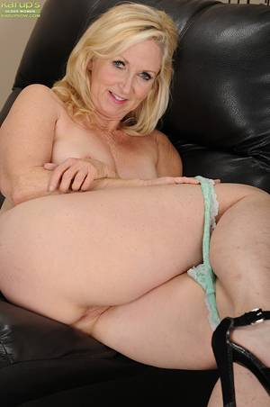 Blonde Mature Glasses - ... Lustful mature blonde in glasses getting nude and teasing her gash ...