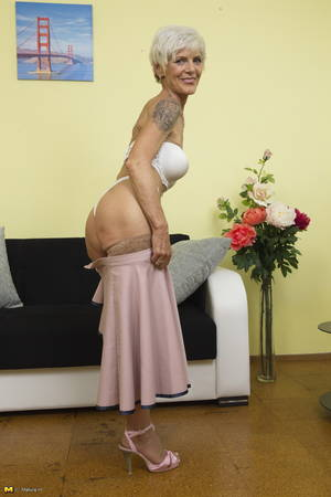 Blonde Mature Short Hair - Short-haired blonde mature teasingly slowly strips down to her sleek nude  holdups and pink sandals