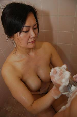 asian oral cum bath - ... Asian MILF Kaoru Mitamura pleasing a swollen cock with her mouth and  tits ...