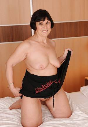 granny brunette - ... Smiley brunette granny uncovering her fatty curves on the bed ...
