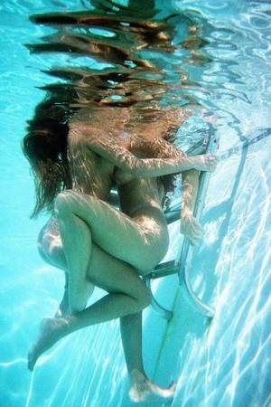 naked lesbians kiss underwater - Two girlfriends kissing and getting close underwater