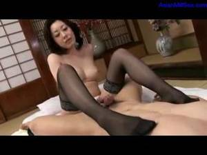 asian japanese stockings - Busty milf in silky smooth stockings gives a great footjob