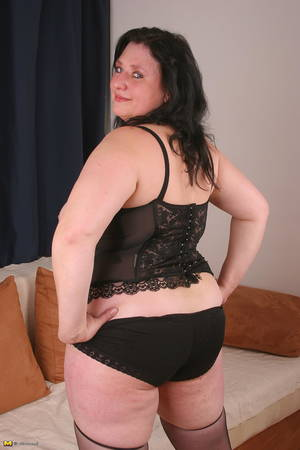 brunette plump mature - Shameless mature brunette spreads her hairy pussy after posing in black  lingerie