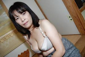 hairy asian milf - ... Asian milf Yumiko undressing her big boobs and hairy pussy ...