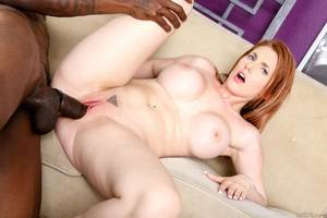 Lilith Lust Interracial Porn - Busty redhead Lilith Lust gets her holes probed by big black cock and  covered with his cum