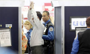 Airline Strip Search Porn - An airline passenger under goes a full-body scan at O'Hare International  Airport, 17 November 2010, in Chicago. Photograph: AP Photo/Charles Rex  Arbogast